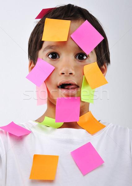Mały chłopca notatka zauważa twarz działalności Zdjęcia stock © zurijeta