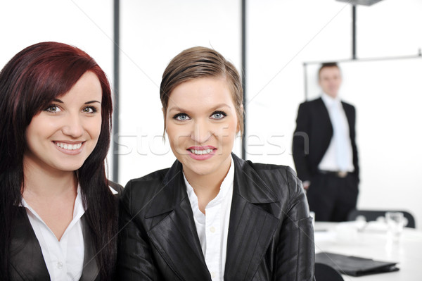Portrait of two happy businesswomen in business presentation at office Stock photo © zurijeta