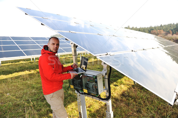 Engineer working with laptop by solar panels  Stock photo © zurijeta
