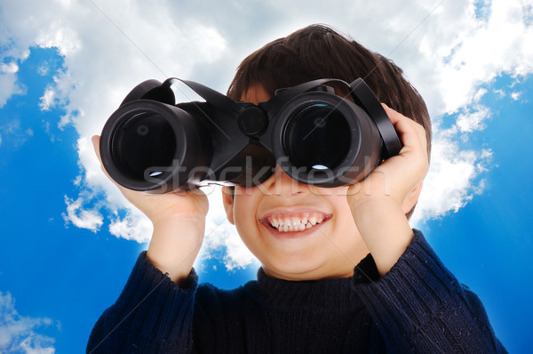 Little cute child with binoculars outdoor Stock photo © zurijeta