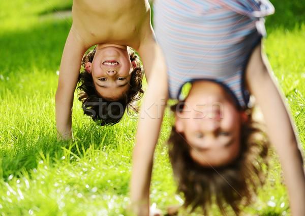 Grupo feliz crianças jogar ao ar livre primavera Foto stock © zurijeta