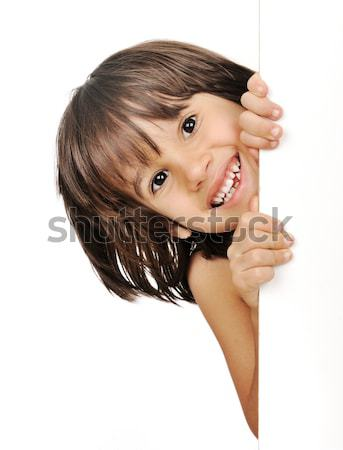 Little boy peeking from behind the advert Stock photo © zurijeta