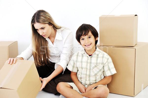 Beautiful woman and little smiling child openig cardboard box Stock photo © zurijeta