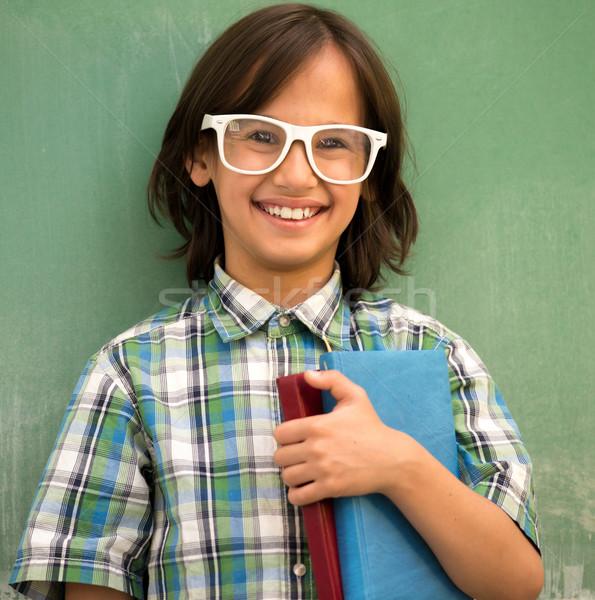 Boldog iskolás fiú pózol oktatás portré könyvek Stock fotó © zurijeta