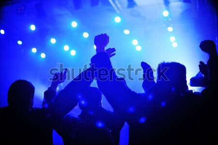 Concert crowd in front of bright stage lights Stock photo © zurijeta