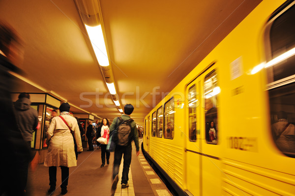 Stock photo: People crowd walking at subway, train in motion