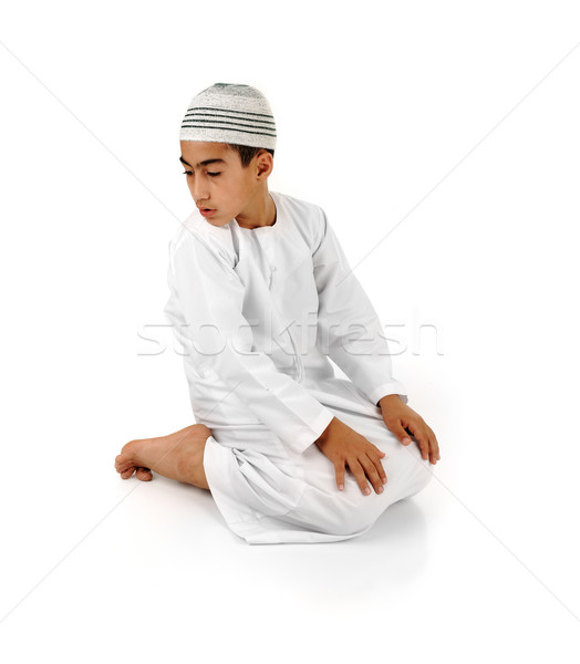 Stock photo: Islamic pray explanation full serie. Arabic child showing complete Muslim movements while praying, s