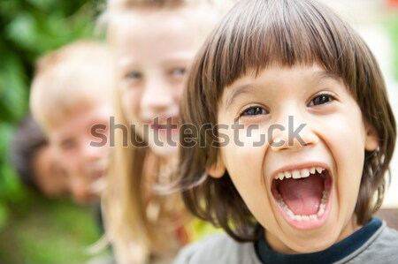 Photo of happy girls with handsome lads in front smiling at camera Stock photo © zurijeta