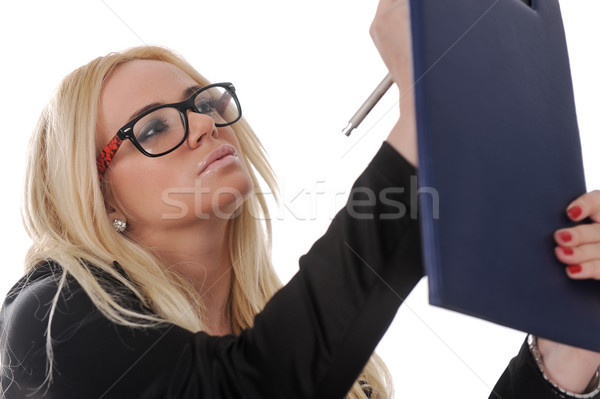 Young  business woman making notes on a clipboard Stock photo © zurijeta