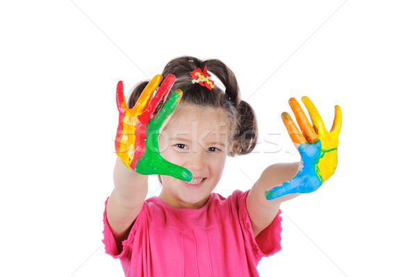 Happy child with colorful painted hands isolated Stock photo © zurijeta