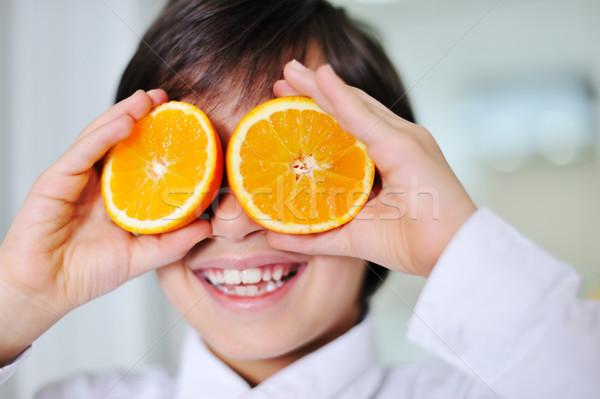 мало мальчика оранжевый Ломтики глазах Сток-фото © zurijeta