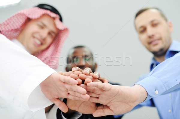 Business team overlapping hands Stock photo © zurijeta