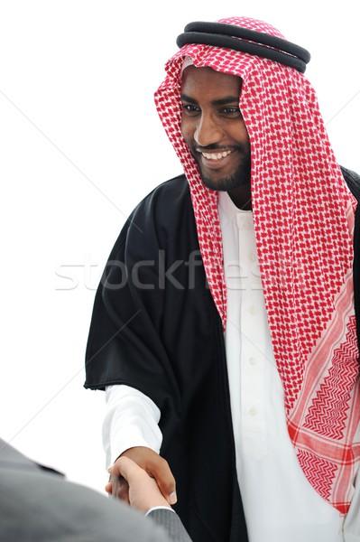 Iş adamları Orta Doğu el sıkışmak el arka plan işadamı Stok fotoğraf © zurijeta
