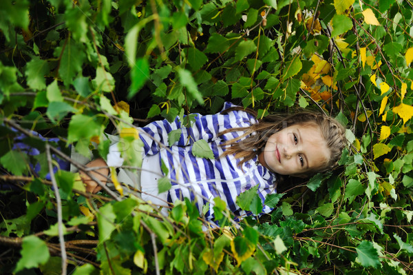 Beauty blond girl laying down on leaves ground Stock photo © zurijeta