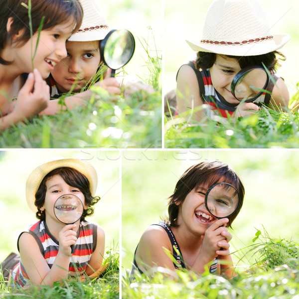 Happy kids exploring nature with magnifying glass Stock photo © zurijeta
