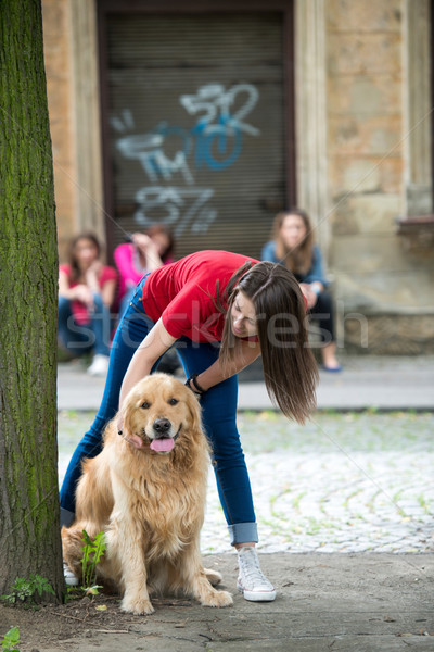 Beautiful teenage girl cuddling a dog Stock photo © zurijeta