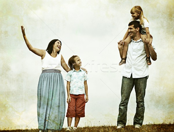 Colorized photo of a young family in nature Stock photo © zurijeta