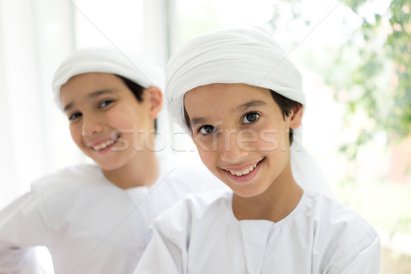 Two Middle eastern brothers together at home Stock photo © zurijeta