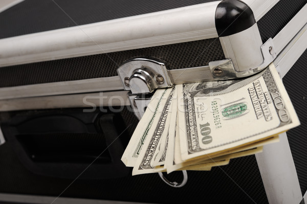 Money coming out of suitcase Stock photo © zurijeta