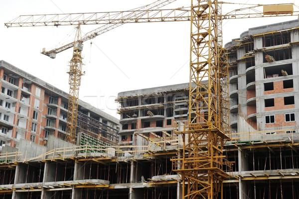 Site buildings under construction and cranes Stock photo © zurijeta