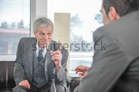 Business people talking  while boss is finger pointing Stock photo © zurijeta