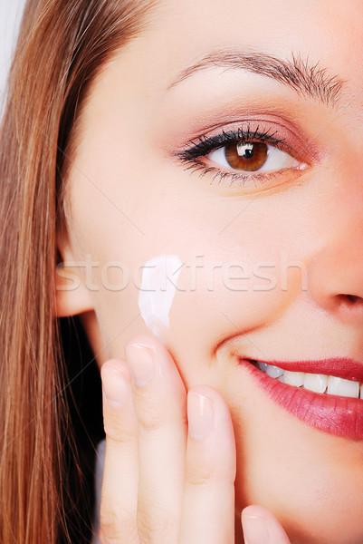 Adorable fille composent joue main visage Photo stock © zurijeta