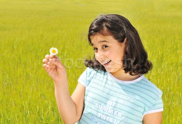 Happy girl  with white flower smiling outdoor Stock photo © zurijeta