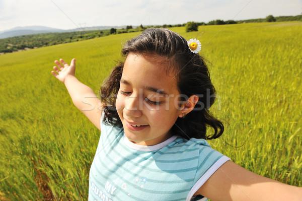 Boldog lány búzamező lány kezek arc nyár Stock fotó © zurijeta