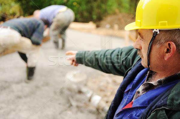 Anziani lavoro lavoratori fresche concrete strumenti Foto d'archivio © zurijeta