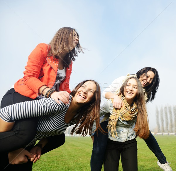 Group of young teenage girls together in nature Stock photo © zurijeta