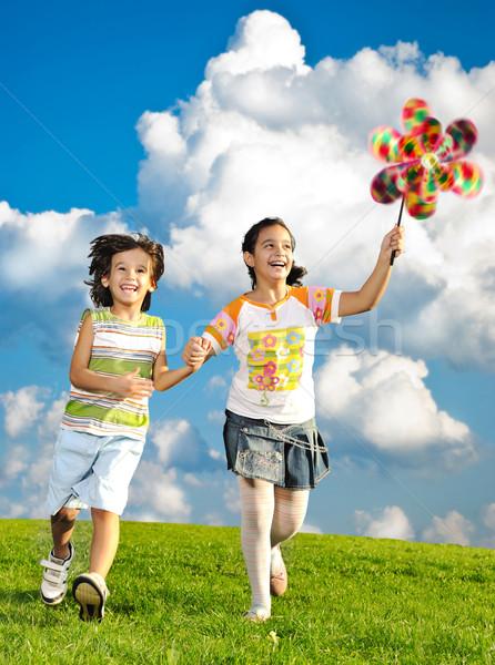 Fantastic scene of happy children running and playing carefreely Stock photo © zurijeta