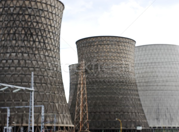 Coal fired power station with cooling towers releasing steam int Stock photo © zurijeta