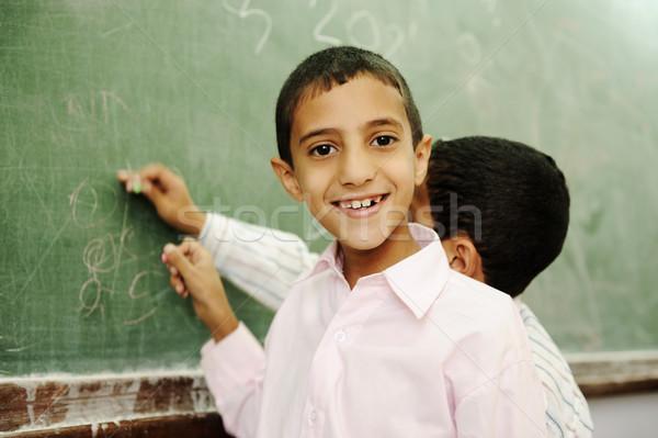Boys drawing and writing on board in school Stock photo © zurijeta