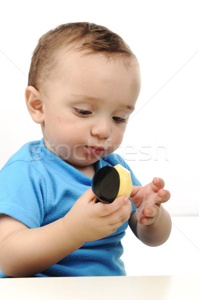 Bonitinho adorável bebê olhos verdes alimentação Foto stock © zurijeta