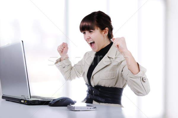 Excited young business woman with her clenched fist Stock photo © zurijeta