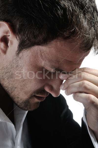 Desperate man with headache Stock photo © zurijeta