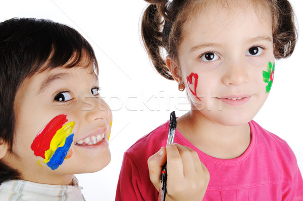Two children painting on faces of each other Stock photo © zurijeta