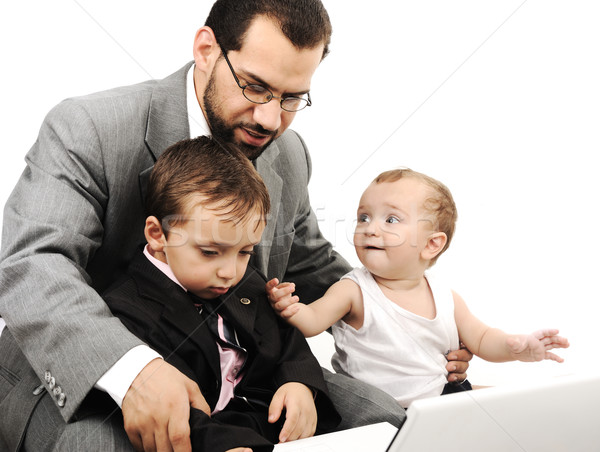 Young father and two kids with laptop Stock photo © zurijeta