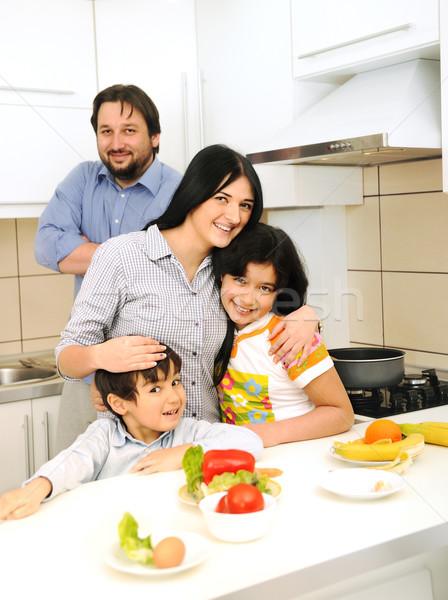 счастливая семья четыре кухне семьи девушки улыбка Сток-фото © zurijeta