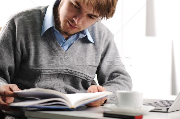 Moço leitura livro secretária escolas laptop Foto stock © zurijeta