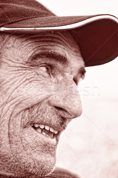 Closeup Profile on a Smiling Old Man With a Grey Beard Stock photo © zurijeta