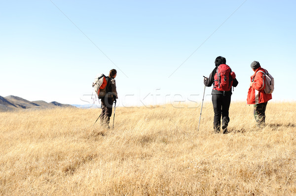 Sport hiking in mountains, walking and backpacking Stock photo © zurijeta