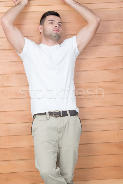 Male model leaning on wooden frame Stock photo © zurijeta