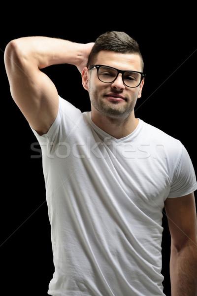 Mosolyog férfi modell szemüveg fehér póló divat Stock fotó © zurijeta