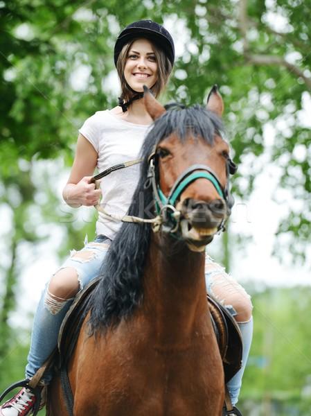 Imagem feliz feminino sessão cavalo aldeia Foto stock © zurijeta