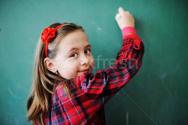 Cute lovely school children at classroom having education activi Stock photo © zurijeta
