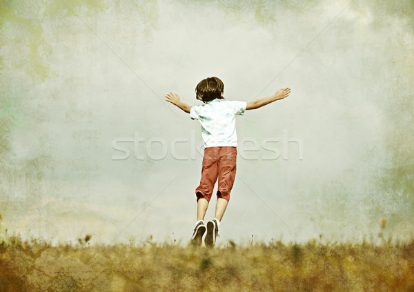 Colorized image of little kid on summer grass meadow in nature Stock photo © zurijeta
