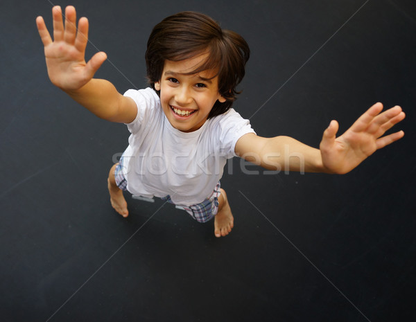 Kid jumping high up Stock photo © zurijeta