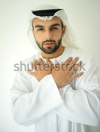 Arab man praying with hands up Stock photo © zurijeta
