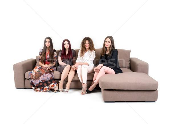 Négy vonzó nők ül kanapé család Stock fotó © zurijeta